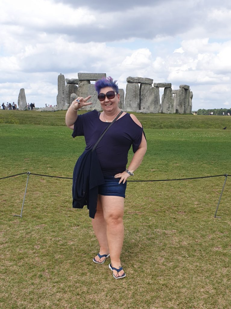 Tonya at Stonehenge 2019 doing a silly pose