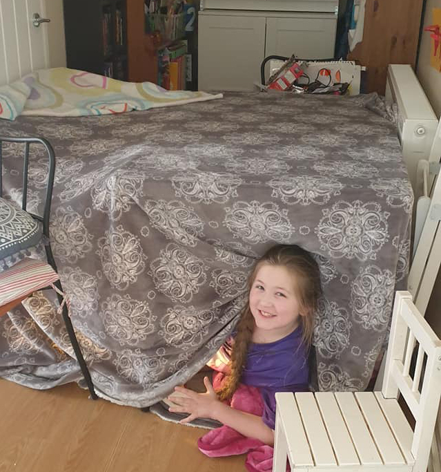 Tent fort - kitchen table & blankets
